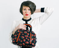 Woman with a fashionable bag Stock Images