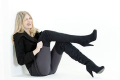 Woman with fashionable black boots Stock Photo