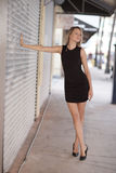 Woman in a fashionable black dress Royalty Free Stock Photography