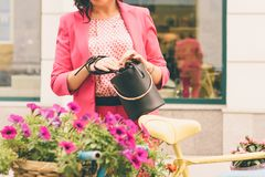 A woman in fashionable clothes royalty free stock photos