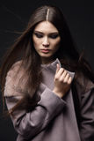 Woman in fashionable coat Stock Photography