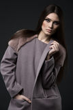Woman in fashionable coat Royalty Free Stock Photo