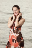 Woman in a fashionable dress Royalty Free Stock Photography