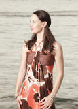 Woman in a fashionable dress Stock Photography