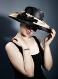 Woman with fashionable hat Stock Photos