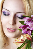Woman with fashionable makeup and flowers Stock Image