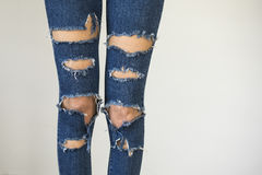 Woman in fashionable ripped Jeans stock photography
