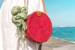 Woman with fashionable stylish red rattan bag and silk scarf outside. Tropical island of Bali, Indonesia. Rattan handbag. Woman with fashionable stylish rattan royalty free stock images