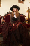 Woman at fashioned dress and renaissance furniture Stock Images
