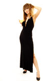Woman in a fasion dress. Woman in black dress having a glass of wine Royalty Free Stock Photos