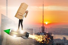 The woman in fast box delivery service on rocket Royalty Free Stock Image