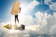 The woman in fast box delivery service on rocket Stock Image