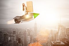 The woman in fast box delivery service on rocket Royalty Free Stock Images