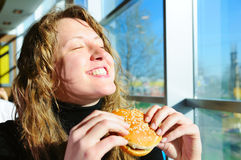 Woman in fast food cafe Stock Photography