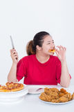 Woman with fast food. High calories food concept Royalty Free Stock Photos