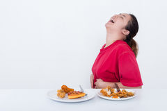 Woman with fast food. High calories food concept Royalty Free Stock Photo