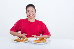 Woman with fast food. High calories food concept Royalty Free Stock Photography