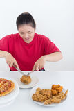 Woman with fast food. High calories food concept Stock Photography