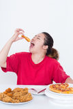 Woman with fast food. High calories food concept Royalty Free Stock Image