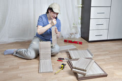 Woman fasten board drawer, using glue, assembly of wooden furnit Stock Image