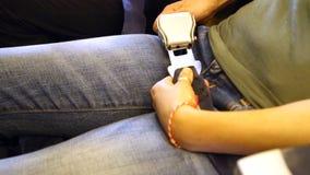 A woman fasten her seat belt stock video