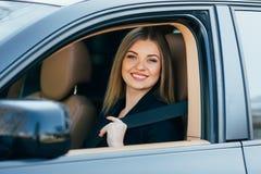 Woman fasten seatbelt Stock Image