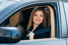 Woman fasten seatbelt Stock Photo