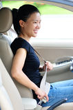 Woman fasten seatbelt. In a car Stock Photography