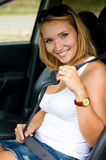 Woman fastens a seat belt in car Royalty Free Stock Images