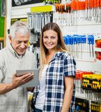 Woman With Father Using Digital Tablet In Hardware Stock Image