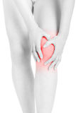 Woman fatigued legs with hands touching knee, clipping path. Woman fatigued legs with hands touching knee, red area isolated on white, clipping path included stock photos