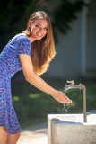 Woman and faucet Royalty Free Stock Photography