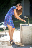 Woman and faucet Royalty Free Stock Image