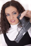 Woman in fear with gun Royalty Free Stock Image