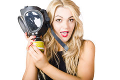Woman in fear holding gas mask on white background Royalty Free Stock Image