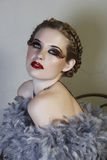 Woman in feather boa stock images
