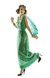 Woman feather in fashion retro sequin dress walking or dancing Royalty Free Stock Photos
