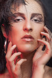 Woman with feather and goth make up Royalty Free Stock Photography