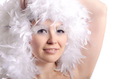 Woman with feather hairs Royalty Free Stock Photography
