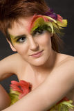 Woman with feathers on face Royalty Free Stock Photo