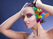 Woman with feathers in hair Royalty Free Stock Images