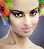 Woman with feathers in hair Stock Images