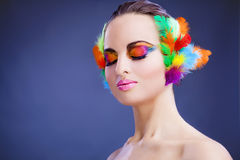 Woman with feathers in hair Stock Photos