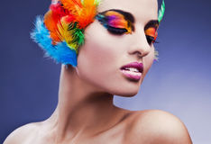 Woman with feathers in hair Stock Photo