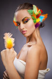 Woman with feathers in hair Stock Image