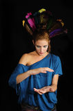 Woman with feathers on the head Stock Images