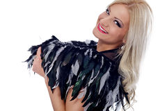 Woman with feathers  on shoulder Stock Photography