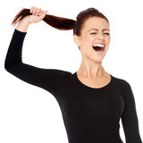 Woman fed up with long hair screaming Stock Photos