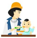 Woman feeding baby. Royalty Free Stock Photo