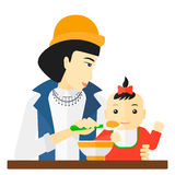 Woman feeding baby. Royalty Free Stock Images